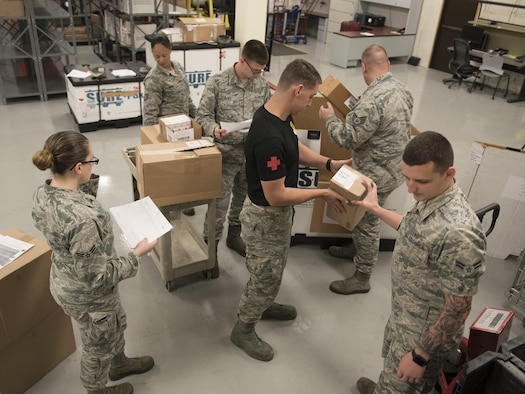 U.S. Air Force Airmen from the 18th Medical Support Squadron assemble a pallet of supplies during a medical material distribution exercise July 13, 2017, at Kadena Air Base, Japan. To ensure all U.S. forces on Okinawa are ready to fight at a moment's notice, the 18th MDSS provides medical supplies to all DoD service members, dependents and civilians. (U.S. Air Force photo by Senior Airman John Linzmeier)