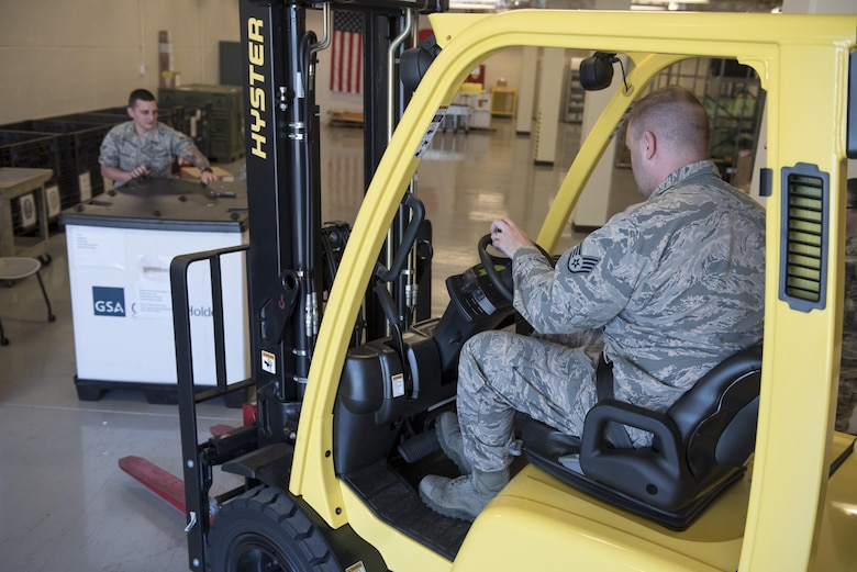 U.S. Air Force U.S. Air Force Airman 1st Class Brett Silverman and Staff Sgt. Jared Bland, 18th Medical Support Squadron medical logistics technicians, load a pallet of supplies onto a forklift during a medical material distribution exercise July 13, 2017, at Kadena Air Base, Japan. During the exercise, 18th MDSS Airmen were challenged to meet the demands of their regular customers for real-world operations and respond to simulated crises throughout the Pacific. (U.S. Air Force photo by Senior Airman John Linzmeier)
