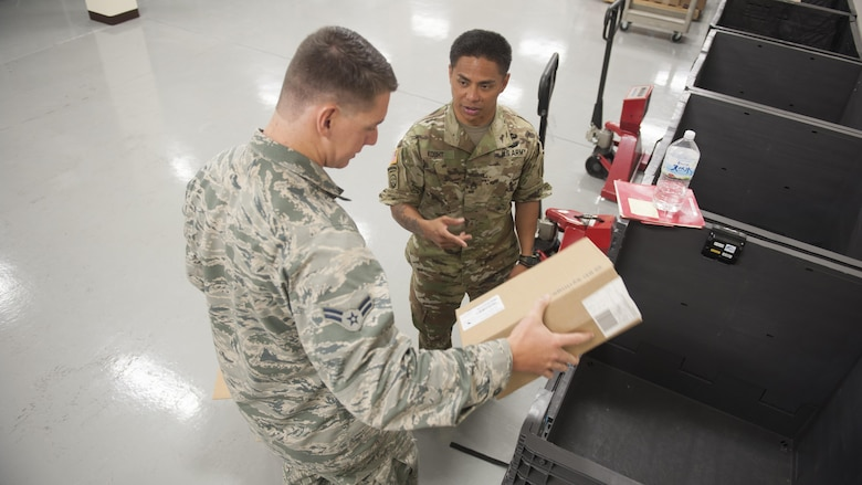 U.S. Air Force Airman 1st Class Rock Remillard, 18th Medical Support Squadron medical logistics technician, and U.S. Army Staff Sgt. Don Kosht, 1-1 Special Forces Group medical logistics NCO, check the supplies for a mock shipment during  a Theater Lead Agent for Medical Materiel – Pacific (TLAMM-P) joint exercise July 13, 2017, at Kadena Air Base, Japan. The TLAMM-P team oversees resupply of the medical needs for U.S. and allied forces in the Pacific region. (U.S. Air Force photo/ Airman 1st Class Greg Erwin)