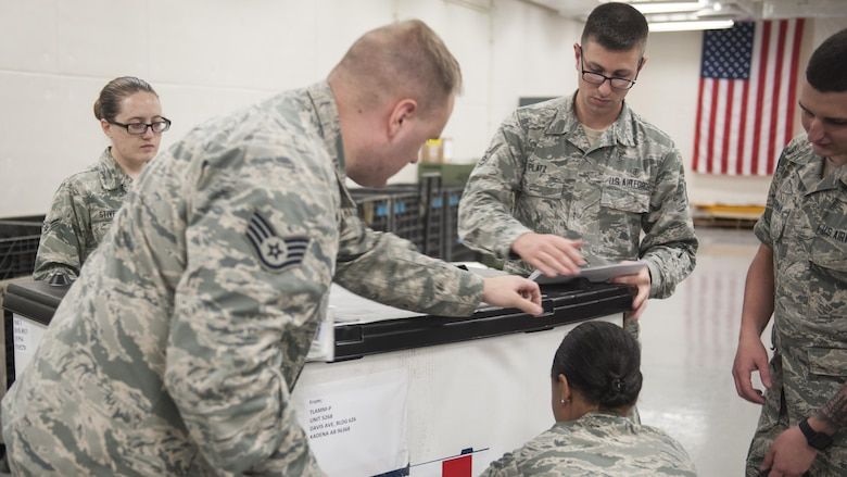 U.S. Air Force 18th Medical Support Squadron members label and pack a crate of medical supplies during the Theater Lead Agent for Medical Materiel – Pacific (TLAMM-P) joint exercise July 14, 2017, at Kadena Air Base, Japan. Medical missions throughout the island depend on the 18th MDSS in order to function, such as the Neonatal Intensive Care Unit at Camp Foster, which cares for premature born infants, or the 18th Aerospace Evacuation Squadron, which transports patients to higher medical care. (U.S. Air Force photo/ Airman 1st Class Greg Erwin)