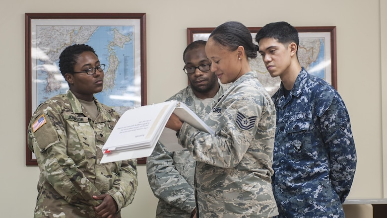 U.S. Air Force Tech. Sgt. Danyelle Saboy, 18th Medical Support Squadron medical logistics technician, briefs U.S. Staff Sgt. Dante Collins, U.S. Navy Petty Officer 3rd Class Augstine Elango, and U.S. Army Specialist Shantasia Johnson, members of the U.S. Pacific Command Armed Services Blood Bank Center during a Theater Lead Agent for Medical Materiel – Pacific (TLAMM-P) joint exercise July 14, 2017, at Kadena Air Base, Japan. To ensure all U.S. forces on Okinawa are ready to fight at a moment's notice, the 18th MDSS provides medical supplies to all DoD service members, dependents and civilians. (U.S. Air Force photo/ Airman 1st Class Greg Erwin)