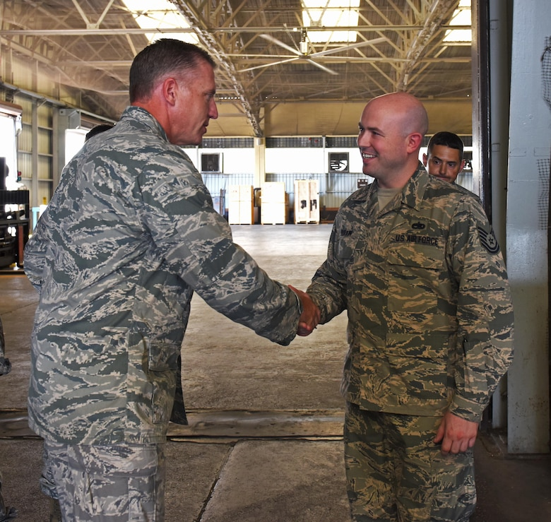 U.S. Air Force Col. David Eaglin (left), 39th Air Base wing commander, coins Tech. Sgt. Sean Durkin, 728th Air Mobility Squadron maintenance training monitor, for superior performance, July 17, 2017 at Incirlik Air Base, Turkey. The 728th AMS provides expertise in three core competencies: aerial port operations, aircraft maintenance, and command and control. (U.S. Air Force photo by Senior Airman Jasmonet D. Jackson)