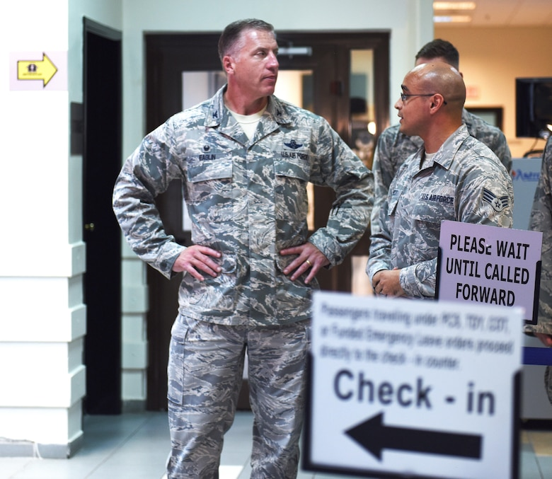 U.S. Air Force Senior Airman Linden Hunnicutt, passenger service agent, briefs Col. David Eaglin, 39th Air Base wing commander, on the passenger travel services that are offered at the terminal July 17, 2017 at Incirlik Air Base, Turkey. U.S. military members and their families are provided with travel via Space-Available (Space-A) Capability. (U.S. Air Force photo by Senior Airman Jasmonet D. Jackson)