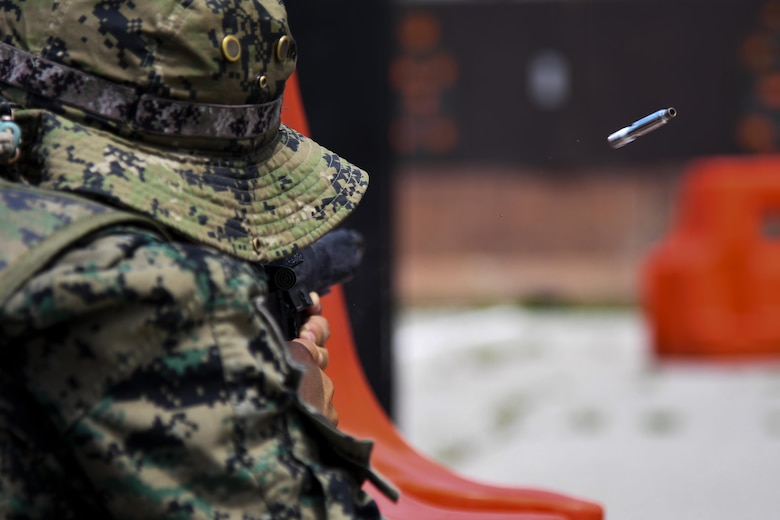 A ROK Special Forces member shoots at a target during joint combat training at Osan Air Base, Republic of Korea, July 19, 2017.  This joint training was integrated as a way to boost unity between the U.S. and South Korean alliance. The training was split into a three session rotation with translators at each station to increase learning capabilities. (U.S. Air force photo by Airman 1st Class Gwendalyn Smith)