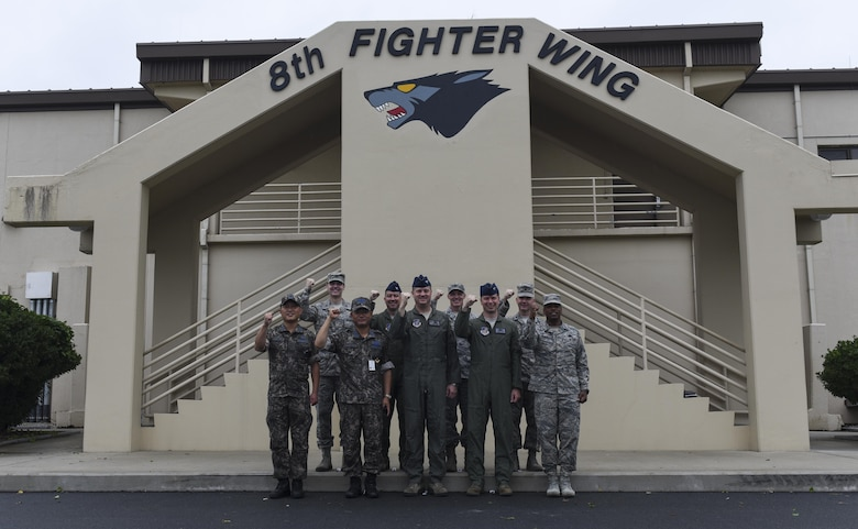 Republic of Korea Air Force Col. Cha, Jun Seon, center left, 38th Fighter Group commander, poses with 8th Fighter Wing leadership at Kunsan Air Base, ROK, July 18, 2017. Cha took part in an immersion program that integrates U.S. and ROKAF leadership and strengthens our ability to conduct joint operations. (U.S. Air Force photo by Senior Airman Michael Hunsaker/Released)