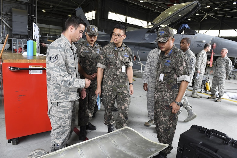 U.S. Air Force Staff Sgt. Joseph Kern, 309th Aircraft Maintenance Group depot aircraft structural maintenance craftsman, shows Republic of Korea Air Force Col. Cha, Jun Seon, 38th Fighter Group commander, a sample of corrosion found on an F-16 Fighting Falcon at Kunsan Air Base, ROK, July 18, 2017. Cha took part in an immersion to help leadership of U.S. and ROKAF gain a better understanding of one another's assets and what each brings to their partnership. (U.S. Air Force photo by Senior Airman Michael Hunsaker/Released)