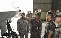 Republic of Korea Air Force Col. Cha, Jun Seon, 38th Fighter Group commander, inspects an F-16 Fighting Falcon during a corrosion control brief at Kunsan Air Base, ROK, July 18, 2017. Cha participated in an immersion that allowed him to see U.S. and ROKAF capabilities and what they can do to strengthen their relationship. (U.S. Air Force photo by Senior Airman Michael Hunsaker)