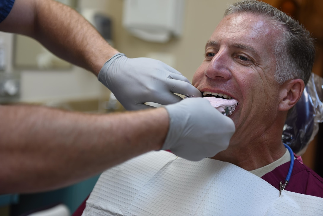Col. David Eaglin, 39th Air Base Wing commander, bites down for a mouth guard during a dental exercise July 18, 2017, at Incirlik Air Base, Turkey. The exercise demonstrated the process for creating mouth guards. (U.S. Air Force photo by Airman 1st Class Kristan  Campbell)