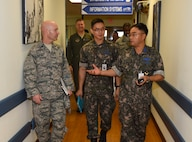 Republic of Korea Air Force Col. Cha, Jun Seon, 38th Fighter Group commander, tours the 8th Medical Group clinic during an immersion at Kunsan Air Base, ROK, July 18, 2017. The immersion program aims to integrate U.S. and ROKAF leadership to strengthen joint capabilities at Kunsan. (U.S. Air Force photo by Senior Airman Michael Hunsaker)