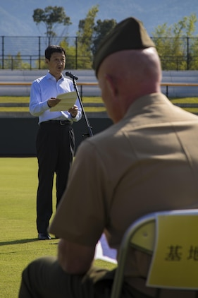 Takahiro Sugawara, director general of Chugoku-Shikoku Defense Bureau, speaks to guests during a scoreboard lighting ceremony at Kizuna Stadium in Iwakuni City, Japan, July 19, 2017. The ceremony offered a private viewing of the almost completed stadium that is to be used by U.S. service members, their families and local Japanese. (U.S. Marine Corps photo by Cpl. Joseph Abrego)