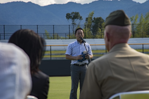 Yoshihiko Fukuda, mayor of Iwakuni City, speaks to guests during a scoreboard lighting ceremony at Kizuna Stadium in Iwakuni City, Japan, July 19, 2017. The ceremony offered a private viewing of the almost completed stadium that is to be used by U.S. service members, their families and local Japanese. (U.S. Marine Corps photo by Cpl. Joseph Abrego)