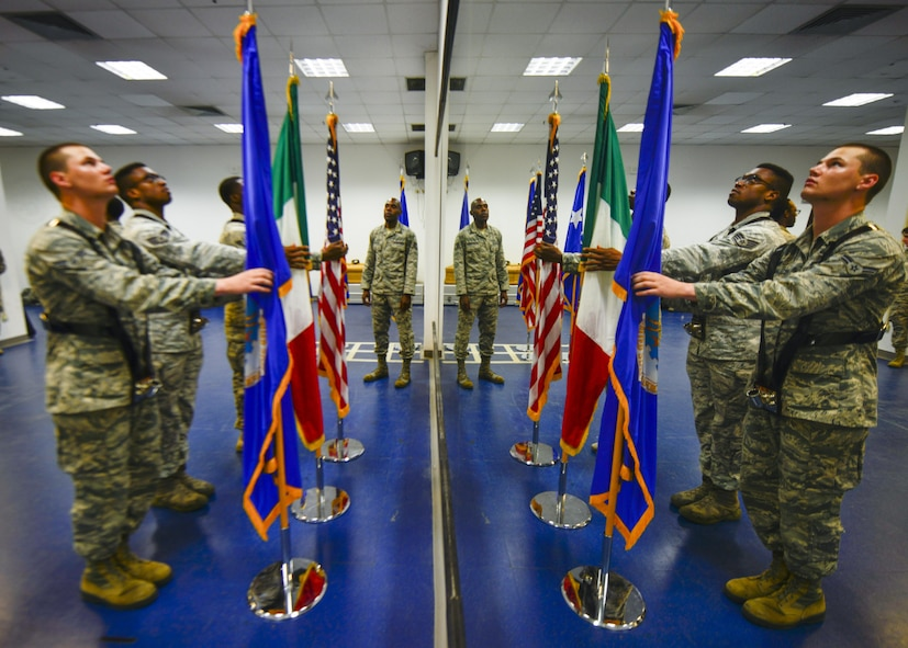Tech. Sgt. Martin Wallace, 31st Fighter Wing Honor Guard lead instructor, instructs Airmen during a base honor guard practice July 10, 2017, at Aviano Air Base, Italy. Wallace currently leads more than 30 Airmen working to become fully qualified honor guardsmen. (U.S. Air Force photo by Senior Airman Cory W. Bush)