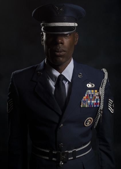 Tech. Sgt. Martin Wallace, 31st Fighter Wing Honor Guard lead instructor, poses for a photo July 13, 2017, at Aviano Air Base, Italy. Wallace currently leads more than 30 Airmen working to become fully qualified honor guardsmen. (U.S. Air Force photo by Senior Airman Cory W. Bush)