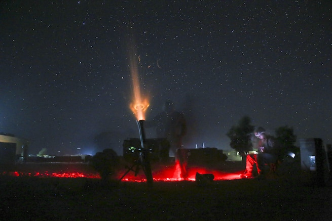 U.S. Marines with Task Force Southwest fire a non-explosive illumination round from an 81mm mortar to deter enemy activity at Camp Shorserack, Afghanistan, July 15, 2017. Advisors assigned to the Task Force assisted their Afghan National Defense and Security Force partners complete Operation Maiwand Four, which saw elements of the Afghan National 215th Corps, 505th Zone National Police and other forces successfully clear the Nawa district center of insurgents. (U.S. Marine Corps photo by Sgt. Lucas Hopkins)