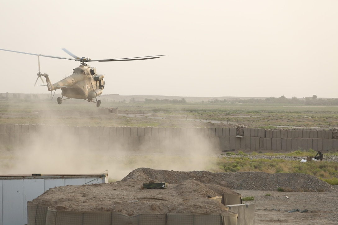An Afghan MI-17 helicopter lands at Camp Shorserack, Afghanistan to deliver supplies to Afghan National Army soldiers with 215th Corps during Operation Maiwand Four July 15, 2017. U.S. Marine advisors with Task Force Southwest assisted their 215th Corps and 505th Zone National Police counterparts throughout the operation, in which elements of the Afghan National Defense and Security Forces successfully cleared the Nawa district center of enemy presence. The Task Force will continue to provide advisory assets to ANDSF as they improve the security posture and establish governance in Nawa. (U.S. Marine Corps photo by Sgt. Lucas Hopkins)
