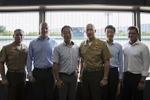 From left to right: U.S. Marine Corps Sgt. Maj. Christopher J. Garza, sergeant major of Marine Corps Air Station (MCAS) Iwakuni, Brian Wottowa, director of Integrated Program Management Office with the Defense Policy Review Initiative, Yoshihiko Fukuda, mayor of Iwakuni City, U.S. Marine Corps Col. Richard F. Fuerst, commanding officer of MCAS Iwakuni, Takahiro Sugawara, director general of Chugoku-Shikoku Defense Bureau, and John Lackie, deputy director of IPMO with DPRI, pose for a photo during a tour of Kizuna Stadium in Iwakuni City, Japan, July 19, 2017.  Joint efforts between MCAS Iwakuni personnel, the locals of Iwakuni City and Fukuda have led to the upcoming completion of the stadium for U.S. service members, their families and local Japanese.  (U.S. Marine Corps photo by Cpl. Joseph Abrego)
