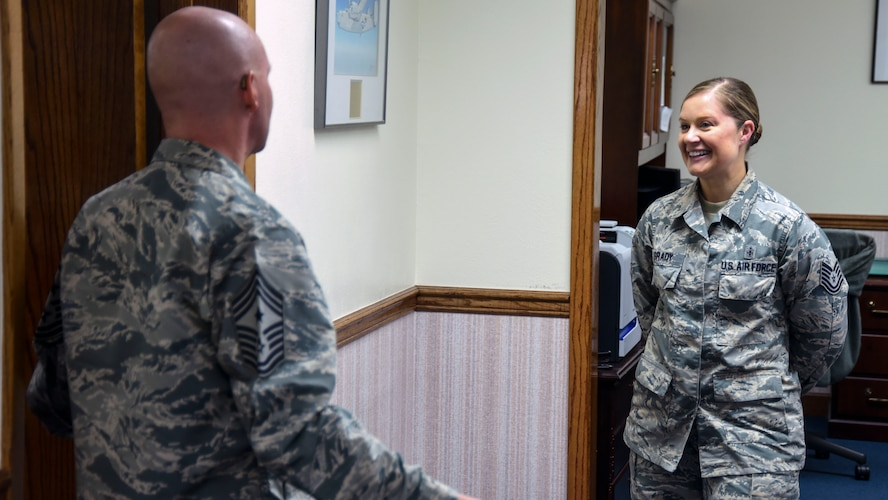 Chief Master Sergeant Thomas F. Good, Twentieth Air Force Command Chief, speaks with Tech. Sgt. Kate Grady, 377th Air Base Wing junior executive officer, at Kirtland Air Force Base, July 18. Grady explained her role in the wing front office, as well as her previous job as a bioenvironmental technician. (U.S. Air Force Photo/Senior Airman Chandler Baker)