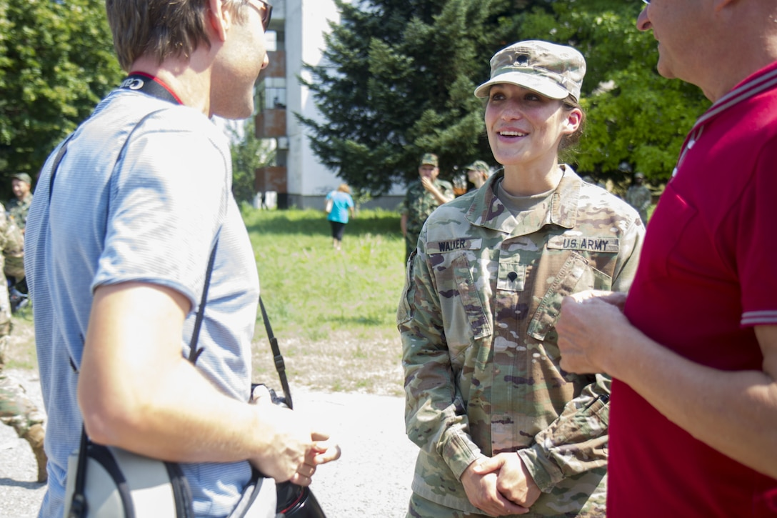 Spc. Tabitha Walker, civil affairs soldier with 361st Civil Affairs Brigade, speaks with a local of Ruse, Bulgaria at a static display of 2nd Cavalry Regiment strykers and Bulgarian military vehicles, July 17 (U.S. Army Reserve photo by Capt. Jeku Arce, 221st Public Affairs Detachment).