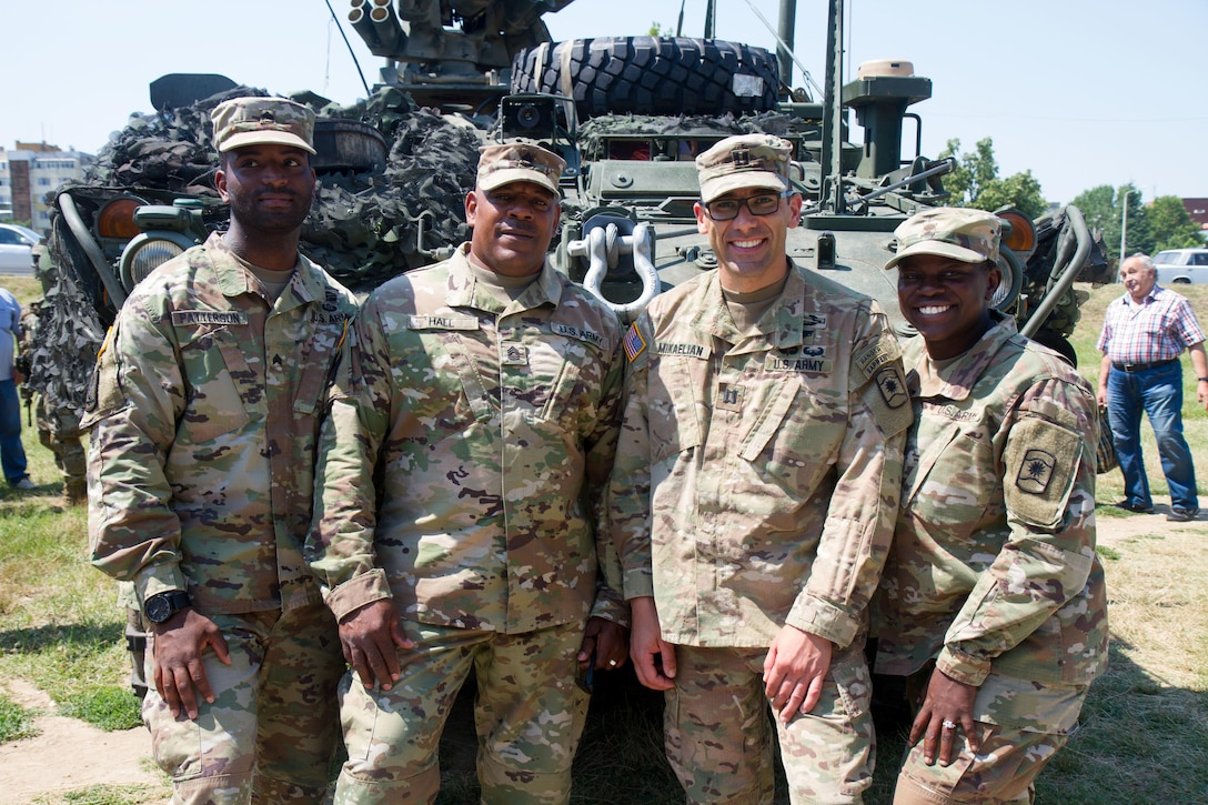 Soldiers of 361st Civil Affairs Brigade pose for a photo in Ruse, Bulgaria at a static display of 2nd Cavalry Regiment strykers and Bulgarian military vehicles, July 17 (U.S. Army Reserve photo by Capt. Jeku Arce, 221st Public Affairs Detachment).