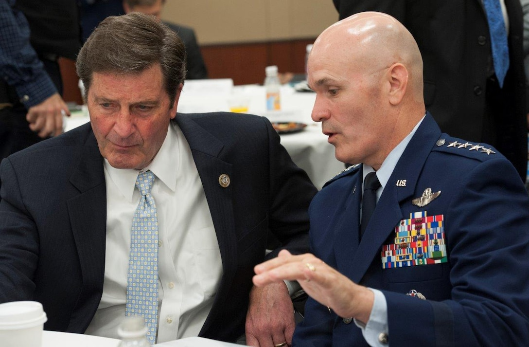 U.S. Rep. John Garamendi and Gen. Carlton Everhart discuss rapid global mobility during a Mobile Air Forces Caucus breakfast in Washington, D.C., July 12, 2017. Everhart was asked to speak with lawmakers about worldwide mobility operations. (U.S. Air Force photo/Tech. Sgt. Robert Barnett)