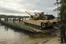 Marines load an M1A1 Abrams tank onto a seven-bay raft system during exercise Iron Wolf at Camp Lejeune, N.C., July 10, 2017. Exercise Iron Wolf is one of the largest exercises conducted this year at Camp Lejeune, integrating 16 different units from II Marine Expeditionary Force to train for realistic scenarios. The Marines are with 8th Engineer Support Battalion and 2nd Tank Battalion. (U.S. Marine Corps photo by Cpl. Luke Hoogendam)
