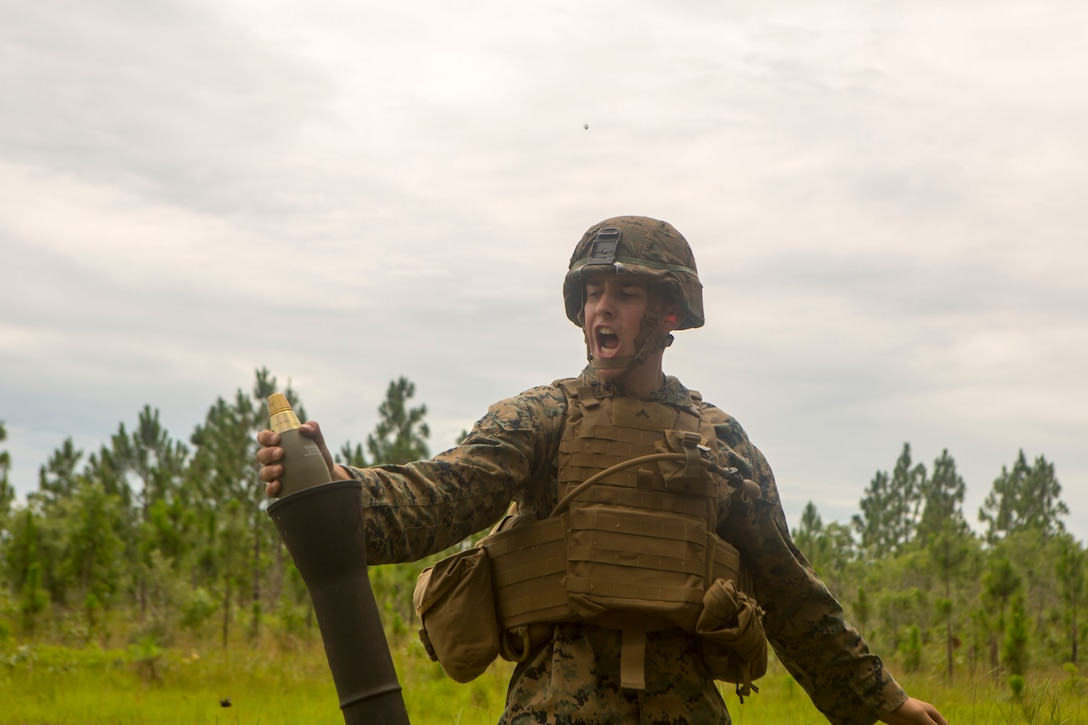Pfc. Alexander Sapp prepares to fire an M821 mortar round during a training event at Camp Lejeune, North Carolina, June 21, 2017. The training event was held to allow Marines from 2nd Air Naval Gunfire Liaison Company the opportunity to conduct call for fire missions with artillery and mortar assets of other units. Sapp is a mortarman with 1st Battalion, 6th Marine Regiment. (U.S. Marine Corps photo by Lance Cpl. Damarko Bones)