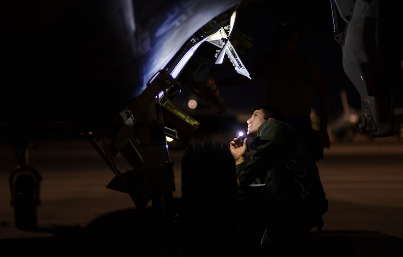 Air Force Maj. Ryan Nickell, a pilot assigned to the 95th Fighter Squadron, Tyndall Air Force Base, Fla., performs a preflight check on an F-22 Raptor at exercise Red Flag 17-3 at Nellis Air Force Base, Nev., July 10, 2017. Air Force photo by Senior Airman Dustin Mullen
