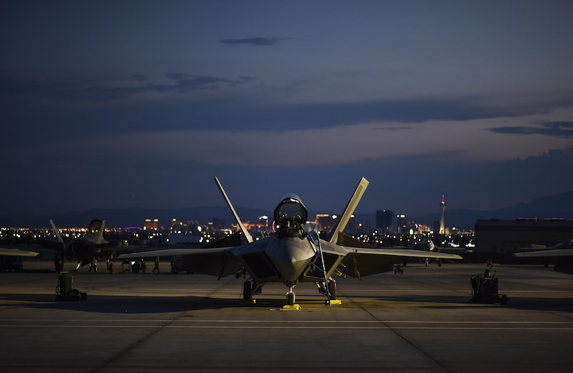 An F-22 Raptor from the 95th Fighter Squadron at Tyndall Air Force Base, Fla., sits on the flight line at Nellis Air Force Base, Nev., during exercise Red Flag 17-3, July 10, 2017. Air Force photo by Senior Airman Dustin Mullen