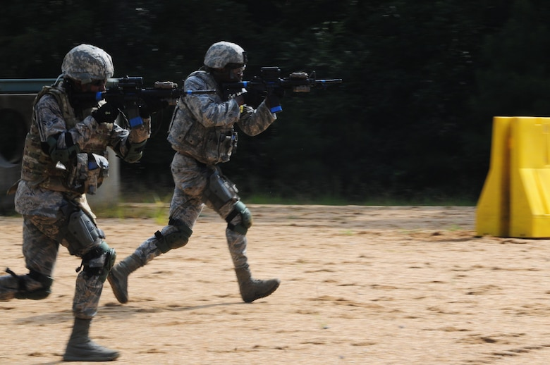 "Members of the 916th Security Forces Squadron sprint into position during ""shoot, move and communicate"" training on July 16, 2017, at Seymour Johnson Air Force Base, North Carolina. (U.S. Air Force photo by Senior Airman Jeramy Moore)"