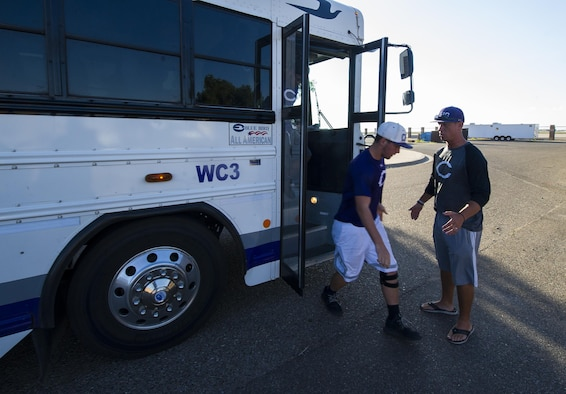 Clovis High School football players step off a bus during their tour at Cannon Air Force Base, NM, July 19, 2017. The high school students took a brief tour through the 26th STS facility and were quickly put to the test as they performed exercises that Joe instructed them to do. (U.S. Air Force photo by Senior Airman Lane T. Plummer)