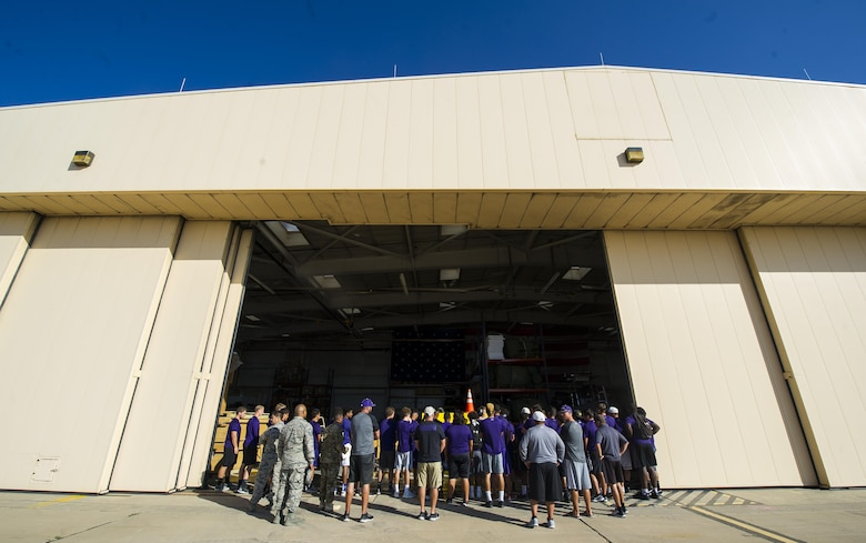 Clovis High School football players crowd around a display set up by the 26th Special Tactics Squadron during the team's tour at Cannon Air Force Base, NM, July 19, 2017.The football team visited the 26th STS to learn about their job and culture. (U.S. Air Force photo by Senior Airman Lane T. Plummer)