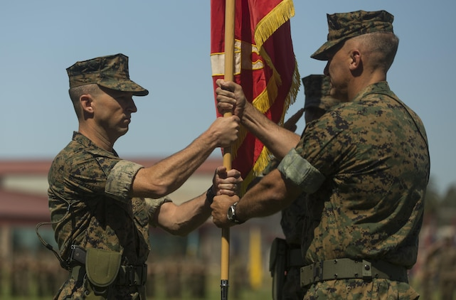Lt. Col. Seth E. Anderson (right) passes the 1st Intelligence Battalion's organizational colors to Lt. Col. B.J. Grass (left) during a change of command ceremony at Camp Pendleton, Calif. June 21, 2017. Grass was the executive officer at the Marine Corps Intelligence schools, Va., and Anderson will attend the U.S. Army War College in Carlisle, Pa. (U.S. Marine Corps photo by Lance Cpl. A. J. Van Fredenberg)