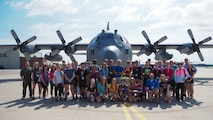 Students from the Aviation Career Education (ACE) camp pose in front of a 934th Airlift Wing C-130 July 16 before taking off for an orientation flight. (Air Force Photo/Paul Zadach)