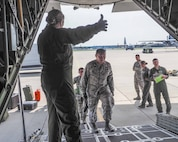 Members of the 934th Aeromedical Evacuation Squadron train aboard a 934th Airlift Wing C-130 flight July 16.  The squadron provides worldwide in-flight medical care. (Air Force Photo/Paul Zadach)