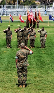 Lt. Gen. Lewis A. Craparotta, I Marine Expeditionary Force commanding general, salutes Marines with I MEF Headquarters Group during a change of command and re-designation ceremony July 6, 2017, at Camp Pendleton, Calif. During the ceremony I MEF Headquarters Group was re-designated as I MEF Information Group to support I MEF in the expanding information environment. (U.S. Marine Corps photo by Lance Cpl. Robert A Alejandre)
