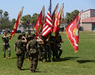 Col. Bobbi Shea (left) and Col. Dawn R. Alonso (right) salute the national and Marine Corps colors in the traditional pass and review during the change of command and re-designation ceremony at Camp Pendleton, Calif., July 6, 2017. During the ceremony I Marine Expeditionary Force Headquarters Group was re-designated as I MEF Information Group to support I MEF in the expanding information environment. (U.S. Marine Corps photo by Lance Cpl. Robert A Alejandre)