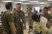 Navy Capt. Frederick Canby, commanding officer of 4th Dental Battalion, 4th Marine Logistics Group, Marine Forces Reserve, talks to corpsmen supporting Innovative Readiness Training Louisiana Care 2017 at East Saint John High School in Reserve, La., July 15, 2017. Several of the patients attending the IRT came for dental services such as fillings, simple dental extractions, screenings for oral cancer and examinations for sports medicine injuries. (U.S. Marine Corps photo by Lance Cpl. Niles Lee/Released)