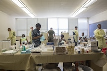 Navy personal with 4th Dental Battalion, 4th Marine Logistics Group, Marine Forces Reserve and Expeditionary Medical Facility Camp Pendleton, prepare for dental procedures at Amite High School in Amite, La., during Innovative Readiness Training Louisiana Care 2017, July 15, 2017. MARFORRES units like 4th Dental Battalion are working closely with other medical units and services from across the country to provide medical, dental and optometry care to the local community at no cost to patients. (U.S. Marine Corps photo by Lance Cpl. Niles Lee/Released)