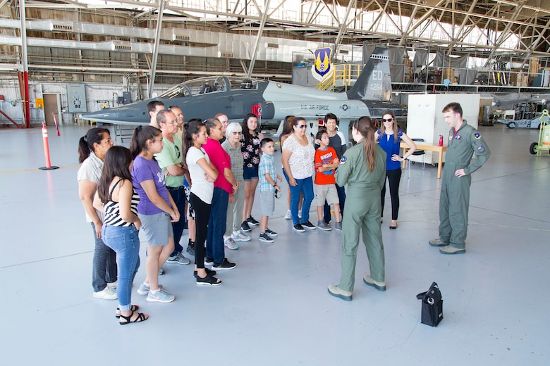 Tech Trekkers receive a plane-side briefing about flight test next to a T-38 Talon Supersonic Trainer in Hangar 1207. 