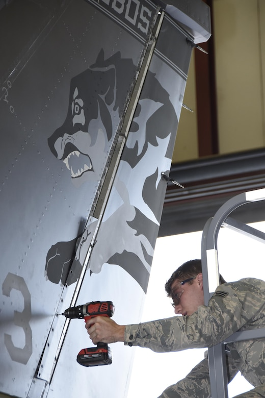Senior Airman Nicholas Jones, 114th Aircraft Maintenance Squadron sheet metal mechanic, removed a panel from the tail of an F-16 during the de-paneling Phase of a phase maintenance inspection at Joe Foss Field, July 8, 2017.  Each aircraft is required to go through a phase inspection every 400 flight hours to ensure all systems are functioning with in Air Force regulations.  (U.S. Air National Guard photo by Master Sgt. Christopher Stewart/Released)