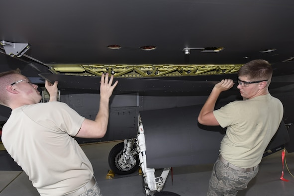 Airman 1st Class Joseph Schuch, and Senior Airman Austin Cole, 114th Aircraft Maintenance Squadron phase mechanics, removed a panel from under the wing of an F-16 during the De-paneling Phase of a phase maintenance inspection at Joe Foss Field, July 8, 2017.  Each aircraft is required to go through a phase inspection every 400 flight hours to ensure all systems are functioning with in Air Force regulations.  (U.S. Air National Guard photo by Master Sgt. Christopher Stewart/Released)