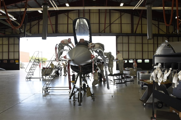 Airmen of 114th Aircraft Maintenance Squadron phase inspection element removed paneled from an F-16 during the De-paneling Phase of a phase maintenance inspection at Joe Foss Field, July 8, 2017.  Each aircraft is required to go through a phase inspection every 400 flight hours to ensure all systems are functioning with in Air Force regulations.  (U.S. Air National Guard photo by Master Sgt. Christopher Stewart/Released)