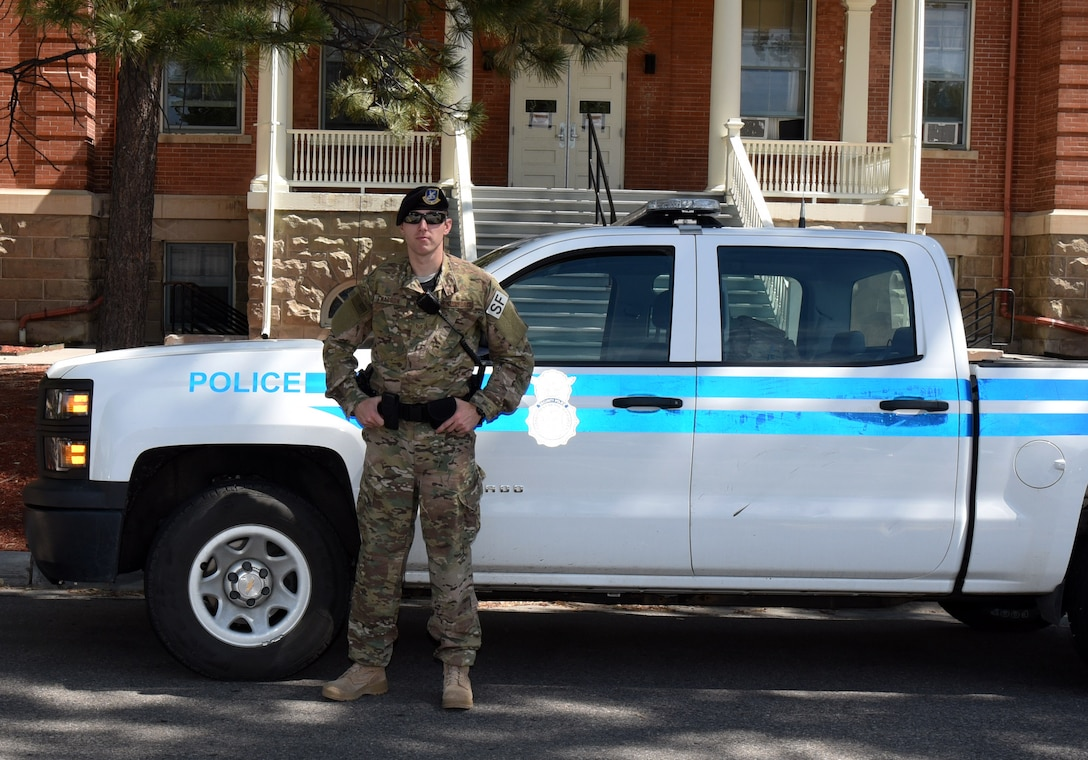 Staff Sgt. Charles Watson, 90th Security Forces Squadron patrolman, poses in front of his patrol vehicle at F.E. Warren Air Force Base, Wyo., July 14, 2017. 90th SFS defenders ensure the security of the installation through law enforcement. (U.S. Air Force photo by Airman 1st Class Breanna Carter)