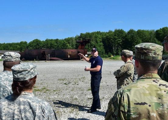 Cody Anderson, a firefighter for the 910th Fire Department, welcomes Soldiers of the 5694th Engineer Detachment from the Army National Guard stationed in Mansfield, Ohio, July 18, 2017, here. The burn pit provides real time firefighting training experiences for not only YARS but for its neighbors too. (U.S. Air Force Photo/Senior Airman Jeffrey Grossi)