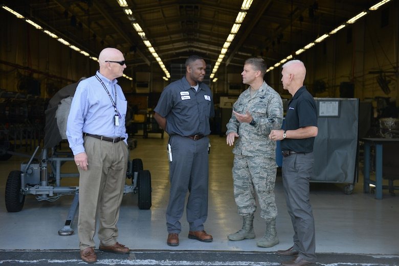Col. William Denham, 14th Flying Training Wing Vice Commander, speaks with the L3 contracted maintainers July 17, 2017, on Columbus Air Force Base, Mississippi. The maintainers on Columbus AFB are contracted out and are a large part of the Columbus AFB community. (U.S. Air Force photo by Airman 1st Class Keith Holcomb)