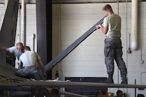 114th Aircraft Maintenance Squadron phase inspection element Armen reinstalled a flap from an F-16 wing during the Fix Phase of a phase maintenance inspection at Joe Foss Field, July 8, 2017.  Each aircraft is required to go through a phase inspection every 400 flight hours to ensure all systems are functioning with in Air Force regulations.  (U.S. Air National Guard photo by Master Sgt. Christopher Stewart/Released)