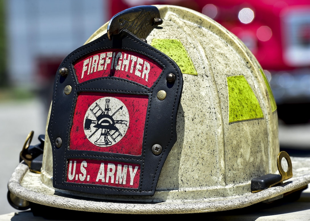 A firemen's helmet belonging to the 5694th Engineer Detachment from the Army National Guard stationed in Mansfield, Ohio sits idle during a break in the action at an airport rescue firefighting exercise, July 18, 2017, here. The 5694th are at YARS for one week while completing their annual training. (U.S. Air Force Photo/Senior Airman Jeffrey Grossi)
