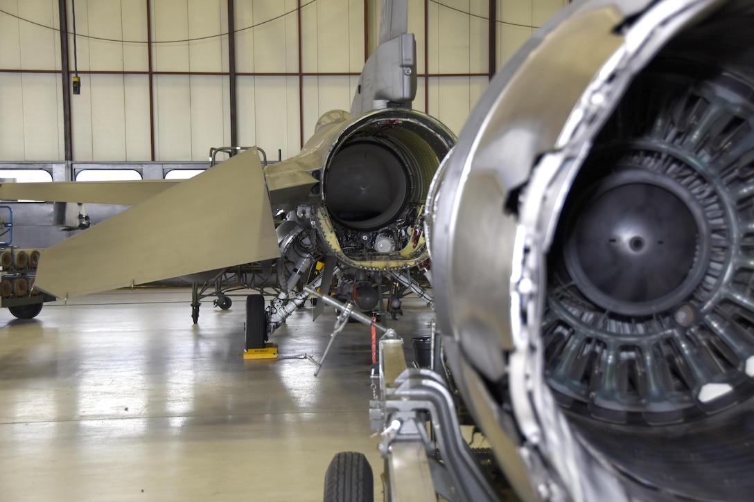 114th Aircraft Maintenance Squadron engine shop Airmen Line up an engine to reinstall into the rear of an F-16 at Joe Foss Field July 18 2017.  Each aircraft is required to go through a phase inspection every 400 flight hours to ensure all systems are functioning with in Air Force regulations.  (U.S. Air National Guard photo by Master Sgt. Christopher Stewart/Released)