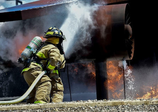 Army firefighters of the 5694th Engineer Detachment from the Army National Guard stationed in Mansfield, Ohio, stand their ground while fighting back a simulated C-130 fire July 18, 2017, here. The 5694th is at YARS for one week while completing their annual training. (U.S. Air Force Photo/Senior Airman Jeffrey Grossi)