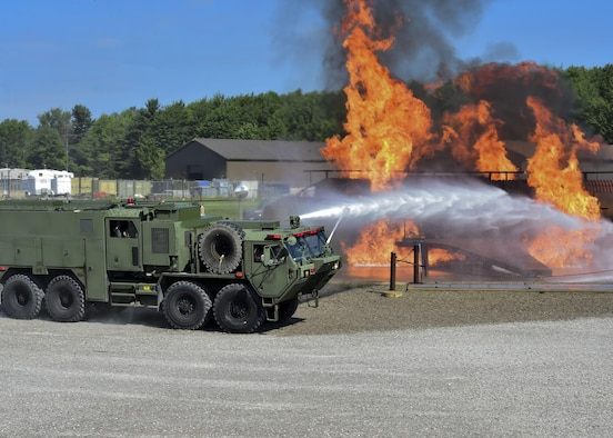 An Army M1142 Tactical Fire Fighting Truck (TFFT) from the 5694th Engineer Detachment from the Army National Guard stationed in Mansfield, Ohio, arrives to the YARS burn pit to fight back a blaze during an airport rescue firefighting exercise July 18, 2017. The TFFT is a multifunctional vehicle, ready to deploy in almost any terrain to combat five types of fires. (U.S. Air Force Photo/Senior Airman Jeffrey Grossi)